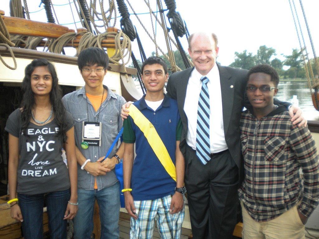 Pictured are, from left, Bansri Patel, Jaewoong Yoo, Priyen Patel, U.S. Sen. Chris Coons and Achille Tenkiang.
